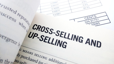 Cross selling  word on book. Business success concept.