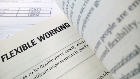 Flexible working word on the book with balance sheet as background