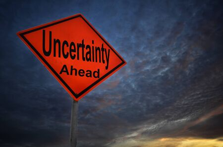 uncertainty: Uncertainty warning road sign with storm background