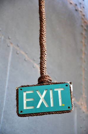 lead rope: Exit sign points the way out of building