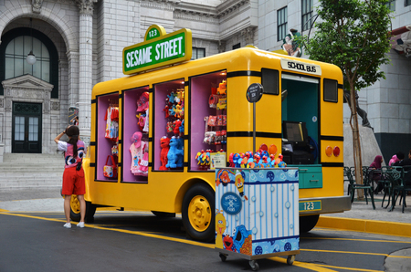 sesame street: SINGAPORE - MAY 29, 2016: Yellow truck that sells Sesame Street merchandise at Universal Studios Singapore. Editorial