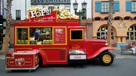 SINGAPORE, JUN 04, 2016: Red truck that selling porncorn at Universal Studios. Universal Studios Singapore is theme park located within Resorts World Sentosa, Singapore.