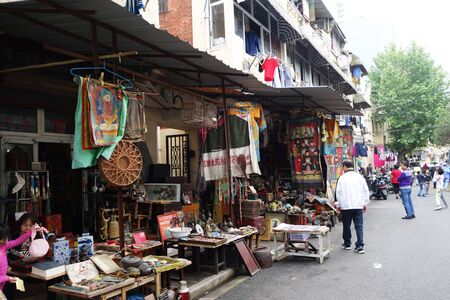 SHANGHAI, CHINA- JUN 04, 2016: Dongtai Lu Antique Market typical shops. The market is great for mementos and souvenirs of Shanghai, China
