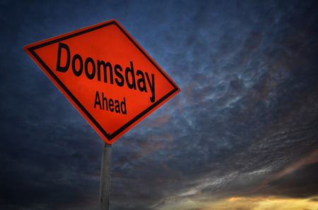 imminent: Doomsday Ahead warning road sign with storm background Stock Photo
