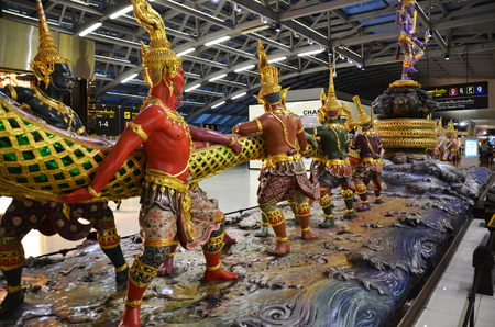 churning: BANGKOK, THAILAND - JUNE 18: Scene of the Churning of the Milk Ocean sculpture at Suvanabhumi Airport, Bangkok. This airport is one of the busiest in Southeast Asia. Editorial