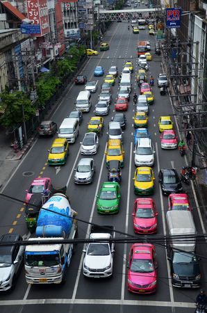 congested: BANGKOK, THAILAND - JUNE 18, 2016: Traffic moves slowly along a busy road in Bangkok, Thailand. Estimated 150,000 new cars join the already heavily congested streets of Bangkok. Editorial