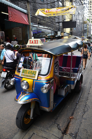 three wheeler: BANGKOK, THAILAND - JUNE 20, 2016: Every day life in Bangkok,People with low income like to use Tuk Tuk because of easy than bus and cheap than meter taxi.