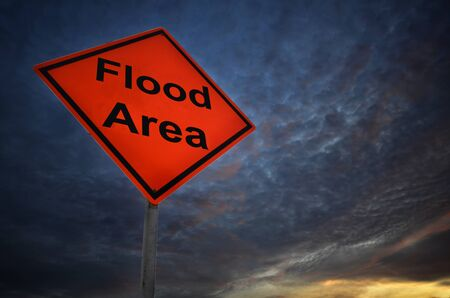 flood area: Flood Area warning road sign with storm background