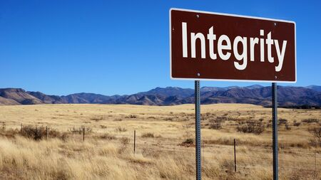 rectitude: Integrity road sign with blue sky and wilderness