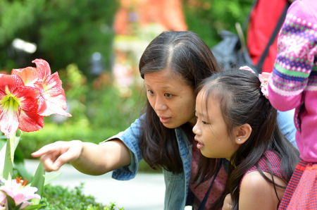 daugther: SINGAPORE- 10 JULY, 2016: Mother and daugther enjoy the beauty in the Flower Dome, Gardens by the Bay