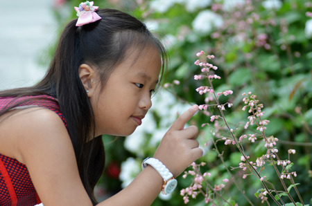 SINGAPORE- 10 JULY, 2016: Pretty young girl enjoys the beauty in the Flower Dome, Gardens by the Bay Editorial