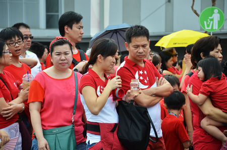 grand kids: SINGAPORE - 30 JULY, 2016: Crowds gather in the new National Studium during National Day Parade rehearsal 2016 in Singapore