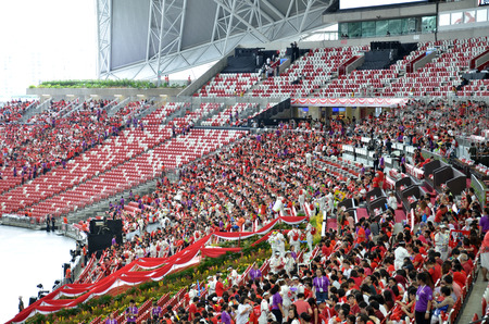 grand child: SINGAPORE - 30 JULY, 2016: Crowds gather in the new National Studium during National Day Parade rehearsal 2016 in Singapore