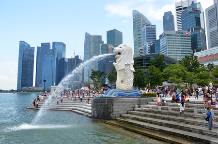SINGAPORE - 07 AUGUST, 2016: The Merlion fountain in Singapore. Merlion is a imaginary creature with the head of a lion,seen as a symbol of Singapore Editorial
