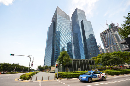 significantly: SINGAPORE - 07 AUGUST, 2016: Central Business District in Singapore. Banking in Singapore is a service industry that has grown significantly in recent years.