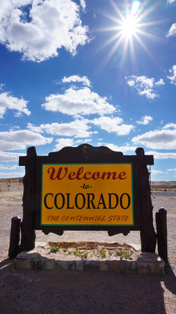 Welcome to Colorado road sign with blue sky Stock Photo