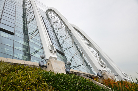 hectares: SINGAPORE- SEP 17, 2016 : Exterior of Cloud Forest with Blue Sky, Gardens by the Bay. It features a 35-metre-tall mountain covered in lush vegetation, shrouding the worlds tallest indoor waterfall.