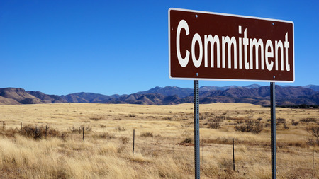 bond street: Commitment road sign with blue sky and wilderness Stock Photo