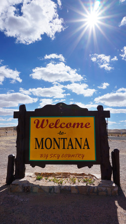 accomplish: Welcome to Montana road sign with blue sky Stock Photo
