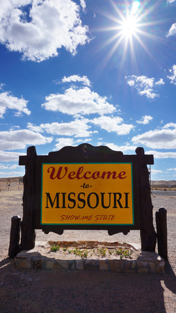 accomplish: Welcome to Missouri road sign with blue sky