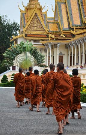 phen: PHNOM PENH, CAMBODIA - OCT 22, 2016: Monks tour the Royal Palace grounds in Phnom Penh, Cambodia Editorial
