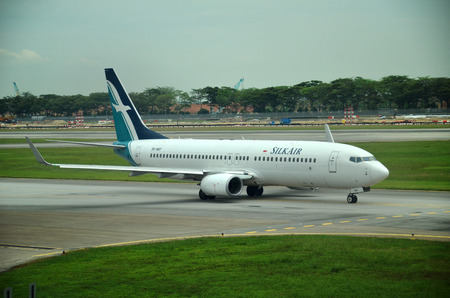 mi: SINGAPORE - OCT 20, 2016: An Airbus A320 from SilkAir (MI) is ready to fly at Singapore Changi Airport