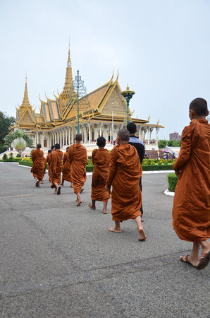 royal: PHNOM PENH, CAMBODIA - OCT 22, 2016: Monks tour the Royal Palace grounds in Phnom Penh, Cambodia Editorial