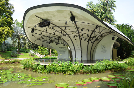 SINGAPORE - OCT 31, 2016: The Shaw Foundation Symphony Stage surrounded by a moat filled with lily pads is used for outdoor concerts at the Singapore Botanic Gardens