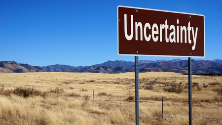 ambivalence: Uncertainty road sign with blue sky and wilderness