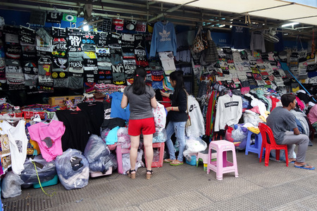 garment industry: SIEM REAP, CAMBODIA - OCT 21, 2016: Unidentified people visit marketplace in Siem Reap. Garment industry of Cambodia accounts for 80 percent of its exports.