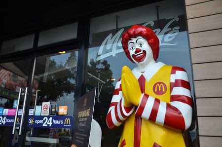 mcdonald: PATTAYA, THAILAND - 20 NOV, 2016: Ronald McDonald character near entryway to McDonals restaurant. Ronald McDonald is a clown character used as the primary mascot of the McDonalds restaurants.
