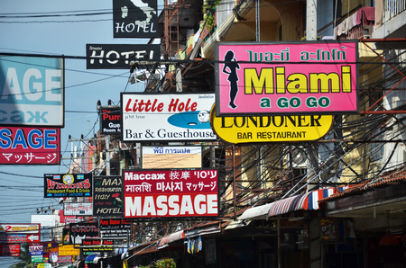 brothel: PATTAYA, THAILAND - 22 NOV, 2016: Massage and other multicolored signs on the street of Beach Road. The average price for one hour of oil massage is 300 baht, around 10 dollars.