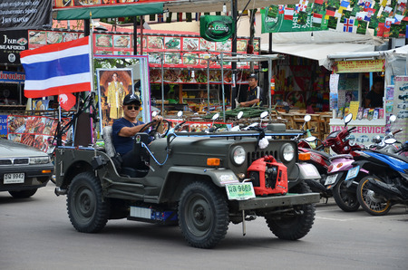 recently: PATTAYA, THAILAND - 19 NOV, 2016: Giant truck carry photo of recently deceased Thailand king in Beach Road, Pattaya in the event of  memorial ceremony to honour His Majesty the King. Editorial