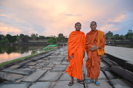 subsequently: ANGKOR WAT, CAMBODIA - OCT 21, 2016: Buddhist monks in Angkor Wat complex. Angkor Wat was first a Hindu, then subsequently, a Buddhist temple complex in Cambodia