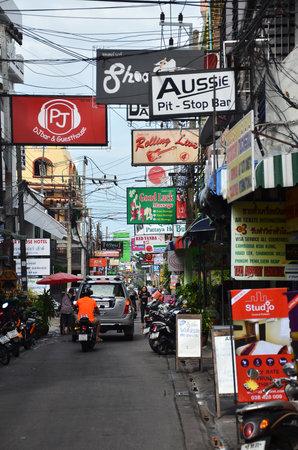 brothel: PATTAYA, THAILAND - 22 NOV, 2016: Multicolored signs on the street of Beach Road, Pattaya.