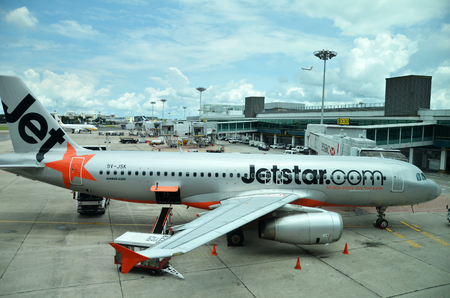 SINGAPORE - 18 NOV, 2016: Jetstar aircraft in Singapore Changi Airport. Jetstar Airways Pty Ltd is an Australian low cost airline headquartered in Melbourne, Australia.