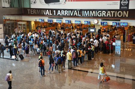 SINGAPORE - 18 NOV, 2016: Travelers enter immigration control at Changi International Airport in Singapore. Sajtókép