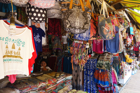 garment industry: SIEM REAP, CAMBODIA- 21 OCT, 2016: Unidentified vendor on marketplace in Siem Reap. Garment industry of Cambodia accounts for 80 percent of its exports.