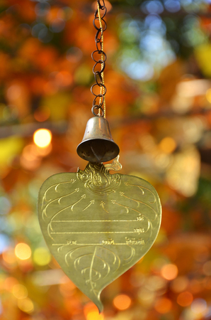 emolument: Gold leaf and bell for write the wish ,Thailand