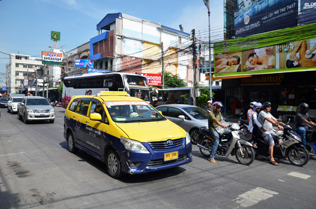 departmentstore: PATTAYA, THAILAND - 22 NOV, 2016: Colorful taxi parking on the street of Pattaya beach and waiting for passenger. Editorial