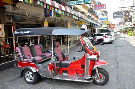 PATTAYA, THAILAND - 22 NOV, 2016: The sweet color service car called Tuk Tuk parking at road side  in Pattaya,Thailand.Pattaya city is famous about sea sport and night life entertainment.