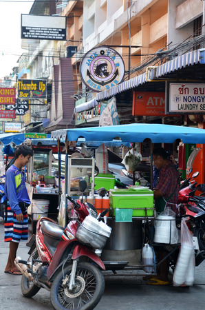 PATTAYA, THAILAND - 19 NOV, 2016: The Sellers of street food stalls in the city of Pattaya, Thailand