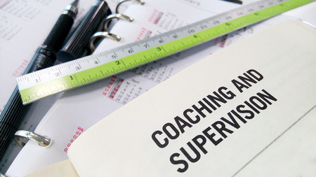 supervision: Coaching and supervision on book and ruler