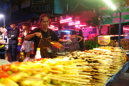 PATTAYA, THAILAND - 19 NOV, 2016: Street food stall in Pattaya. Street food is ready-to-eat food or drink sold by a hawker, or vendor, in a street or other public place, such as at a market or fair.