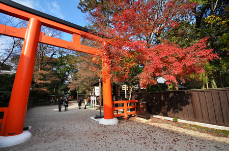 KYOTO, JAPAN - DECEMBER 01, 2016: Tourists visit Shimogamo shrine orange archway in Kyoto, Japan.  Shimogamo Shrine is one of the oldest shrines in Japan.
