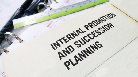 succession planning: Internal promotion and succession planning on book Stock Photo