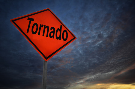 waterspout: Orange storm road sign of tornado with dark cloud Stock Photo