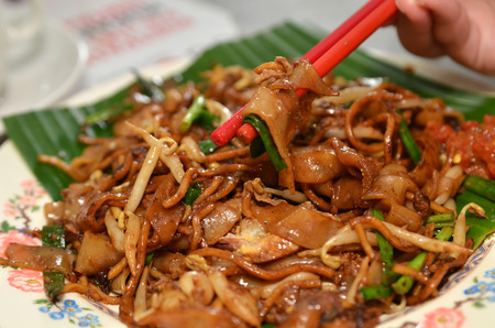char: Fried Penang Char Kuey Teow which is a popular noodle dish in Malaysia