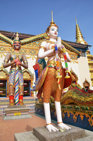 workship: PENANG, MALAYSIA- 29 DECEMBER, 2016: Statue standing outside Wat Chayamangkalaram located in Georgetown, Penang, Malaysia. Editorial