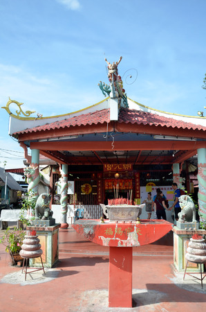 chew: PENANG, MALAYSIA- 29 DECEMBER, 2016: Small temple at the entrance of the Chew Jetty, Penang, Malaysia. Chew Jetty is one of the old Chinese waterfront settlement in Penang.